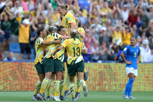 The Matildas celebrate as Chloe Logarzo's cross-turned-shot levels the scores at 2-2