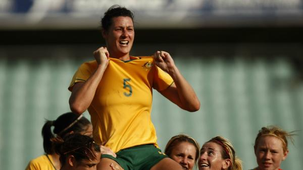Westfield Matildas legend Cheryl Salisbury is carried off by teammates following her retirement.