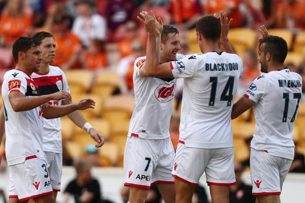 Adelaide United players celebrate a goal