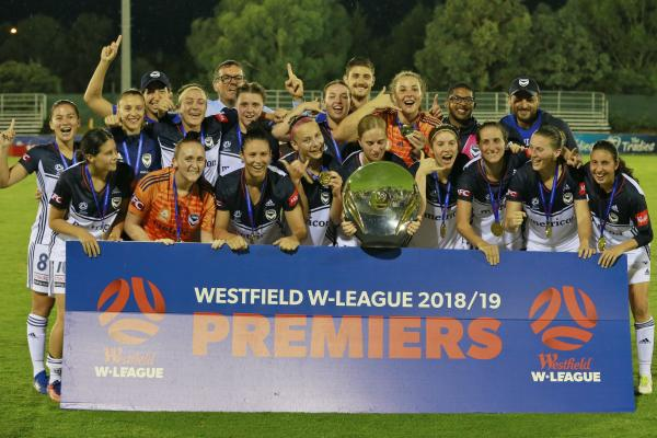 Victory players get their hands on the Premiers' Plate