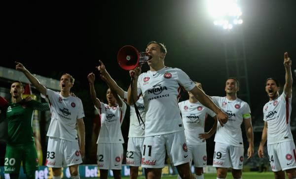 The Wanderers celebrate after win over Mariners.