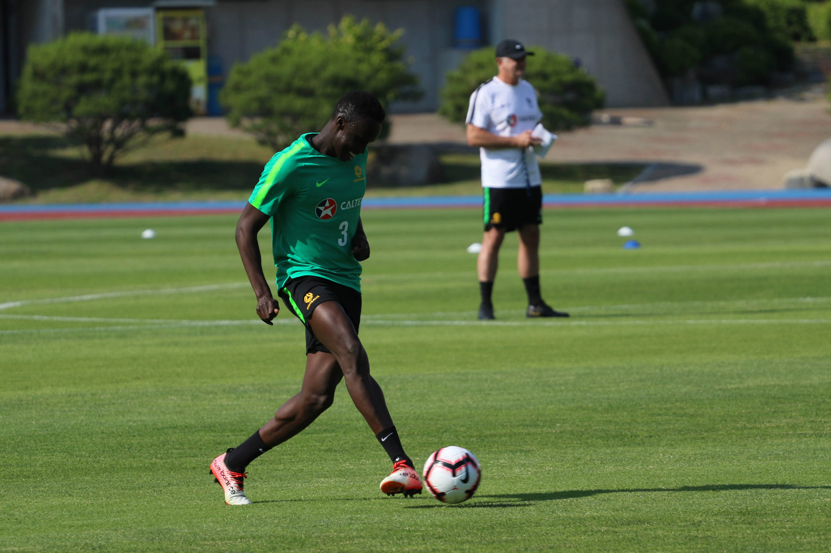 Thomas Deng gets a pass away in training in Busan